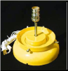 A GAS PUMP GLOBE LAMP STAND IN YELLOW